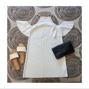 Selling a White knee high flowy dress